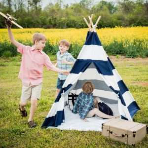 boys playing navy and white striped canvas teepee for kids