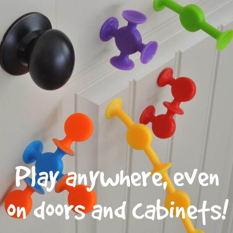 Easy Stikz suction cup toys on a door